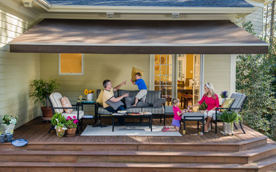 Famiy Time Under A Retractable Awning